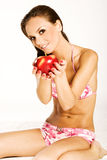 Girl with apple. Beautiful brunette girl holding a red apple Stock Images