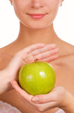 Girl with an apple. Beautiful girl with green juicy apple Royalty Free Stock Photos