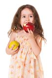 Girl with apple. Little girl with apple, isolated on white background Royalty Free Stock Photo