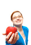 Girl with an apple. Royalty Free Stock Image