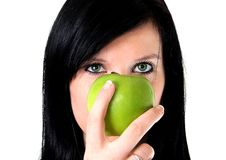 A girl with apple. A girl with a green apple Royalty Free Stock Images