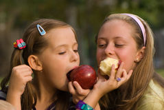 Girl with apple. In park Stock Images