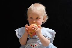 Girl with apple. Little blonde girl with big apple in hands Royalty Free Stock Photography