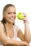 Girl with apple. Portrait of beautiful girl holding a green apple, smiling, isolated on white Stock Photo