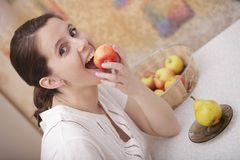 Girl with an apple Stock Photos