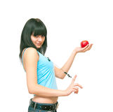 The girl with an apple. The image of the girl holding an apple Royalty Free Stock Image