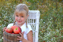Girl with apple basket Stock Image