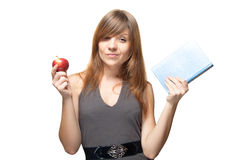Girl with the apple and a book Royalty Free Stock Photography