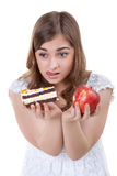 Girl with apple and cake Stock Images
