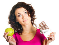 Girl with apple and chocolate Stock Images