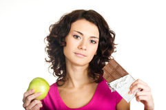 Girl with apple and chocolate Royalty Free Stock Image