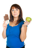 Girl with apple and chocolate Royalty Free Stock Images