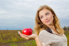 Girl with apple. Cute blondie girl with apple stock photo