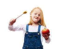 Girl with apple. Girl enchants an apple to a frog Stock Photos