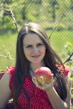 Girl with apple. Fine Brunette Girl with apple Stock Photo