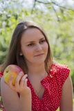 Girl with apple. Fine Brunette Girl with apple Royalty Free Stock Photos
