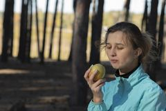 Girl,apple, fitness, outdoors,natural stock photography