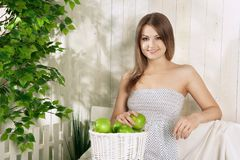 Girl with apple in the garden Royalty Free Stock Photography
