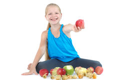 Girl with apple and gooseberry (physalis) Royalty Free Stock Images