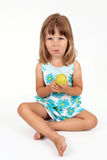 The girl with an apple in hands. On a white background Stock Image
