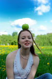 Girl with apple on head Royalty Free Stock Images