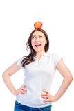 Girl with an apple on her head. Looking to the side Stock Photo
