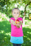 Girl with apple Stock Images