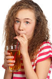 Girl with apple juice Stock Photos