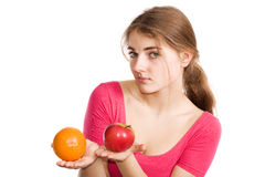 Girl with apple and orange Stock Images
