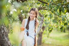 Girl with Apple in the Apple Orchard stock image