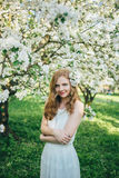 A girl in an apple orchard Stock Image