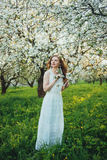 A girl in an apple orchard Stock Photo