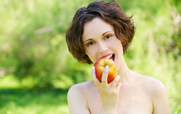 Girl with apple outdoors Royalty Free Stock Images