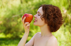 Girl with apple outdoors Royalty Free Stock Photography