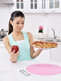 Girl apple and pizza unstable Royalty Free Stock Photos