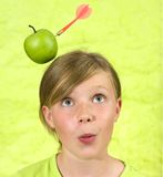 Girl with apple shot from head. Girl with an apple shot from her head (green Royalty Free Stock Photo