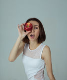 A girl with apple Stock Photography