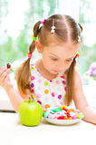 Girl with apple and  sweets Stock Photo