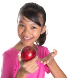 Girl With Apple And Thumbs Up Sign II Stock Images