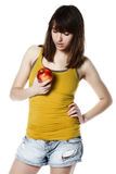 Girl with apple on white Royalty Free Stock Photo