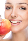 Girl with an apple. On a white background Stock Photos