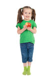 Girl with apple on white Stock Photography