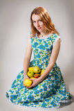 Girl with the apples Stock Images