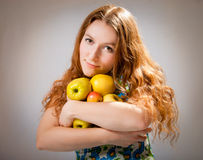 Girl with the apples Royalty Free Stock Photography