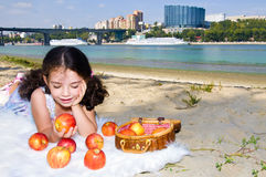 Girl with apples. On the river bank Royalty Free Stock Photo