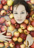 Girl in apples Stock Photography