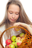 Girl and apples in the basket Royalty Free Stock Image