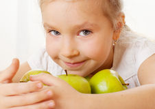Girl with apples Stock Photography
