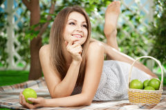 Girl with apples in the garden Stock Photography