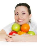 Girl with apples and oranges Stock Photography